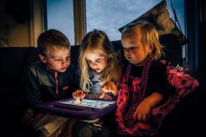 Three children using tablet