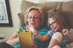 Mum using tablet with child